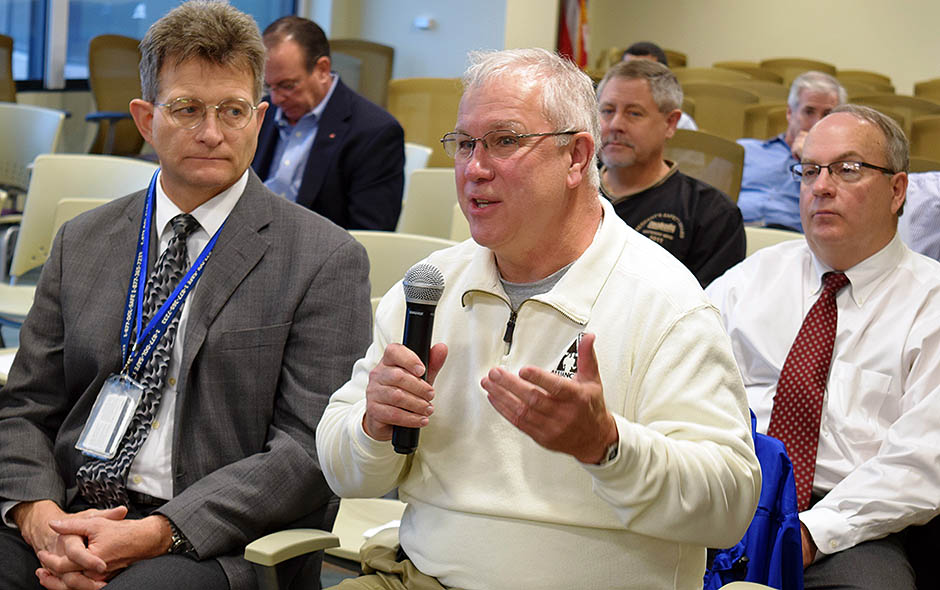 Ken Murray, right, of Alliance Coal poses question for MSHA officials.  At left is Greg Meikle, Chief of Health in Coal.