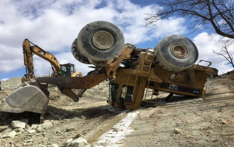 Front loader fallen upside down