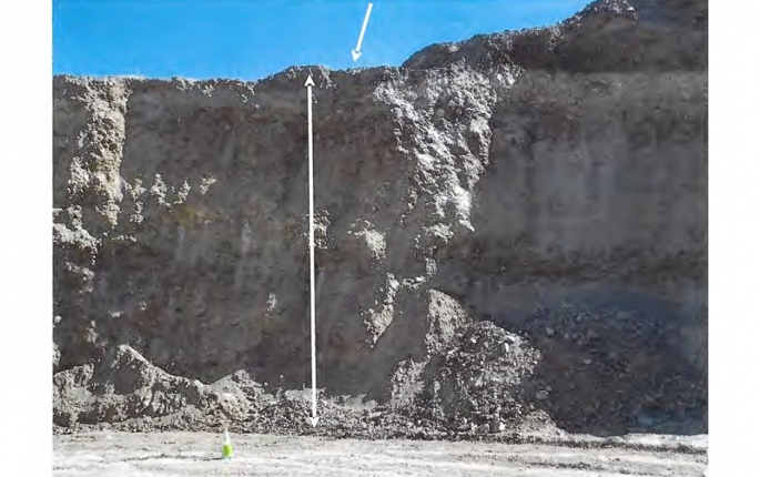 The top arrow indicates where the miner was standing without proper fall protection in relation to the 50-foot highwall drop.