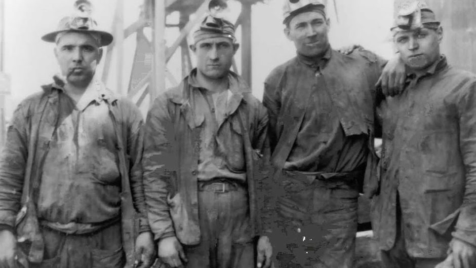 Old Photograph of four miners