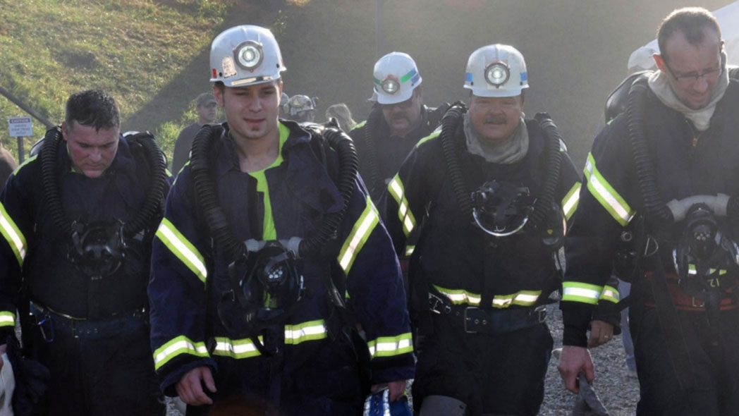 Mine rescue content showing rescuers in action