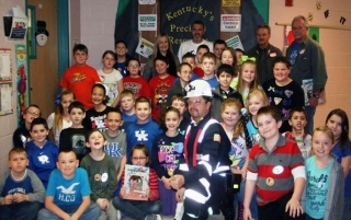 MSHA inspector Danny Pack with third-graders at Hardy Elementary School in Hardy, KY, where he explained the dangers of abandoned mines at the school coal fair.