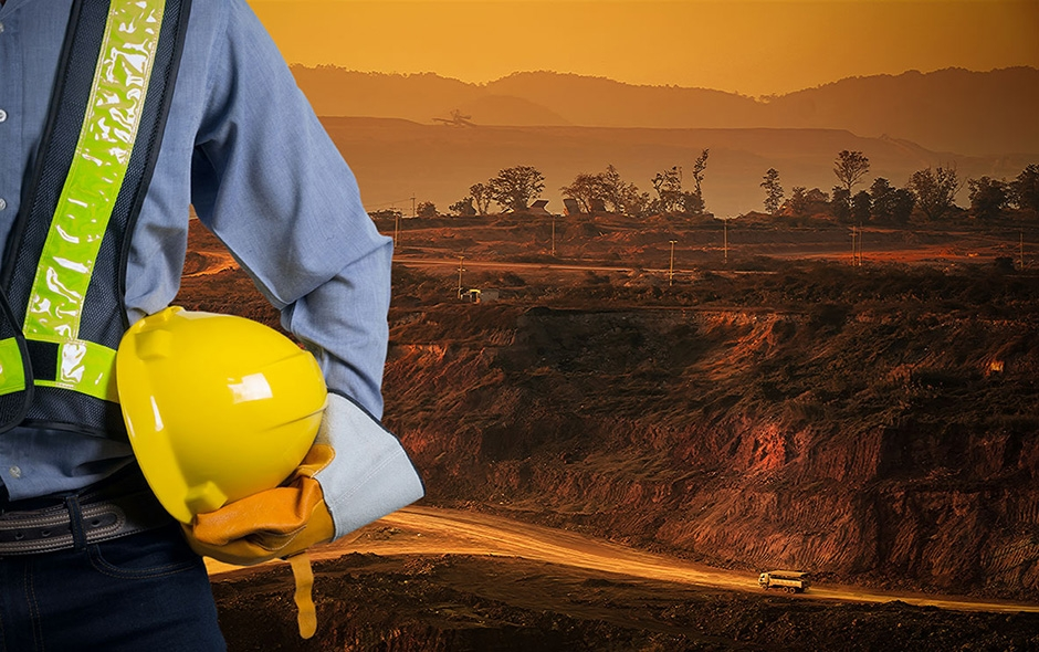 imsgae showing a mine inspector holding his hard hut and about to go inpect a mine