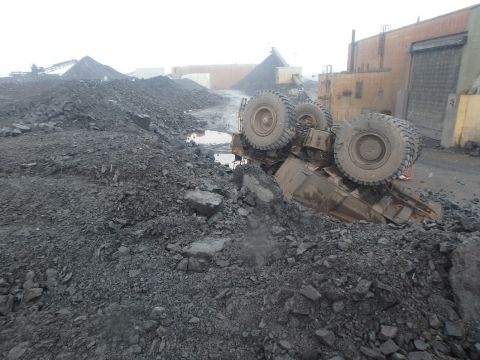 On April 29, 2019, a miner suffered minor injuries when his haul truck traveled over the edge of a stock pile dump point causing the truck to roll onto its top. The driver was wearing a seat belt.