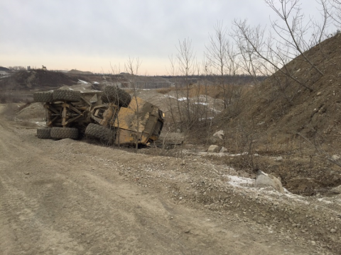 Haul truck turned on side