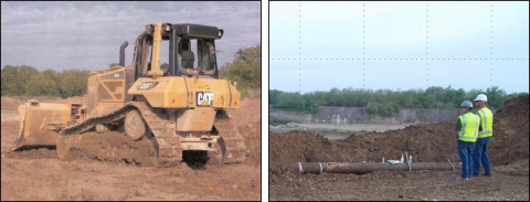 Bull dozer on left, two workers on the right