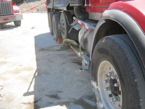 Blown fuel tank on side of truck