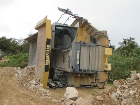 haul truck on its side