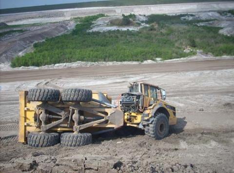 Overturned haul truck