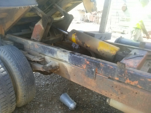 Close up underneath the raised bed where the victim was working. The hydraulic mechanism can be seen.