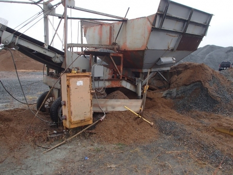 Accident scene where a 25-year-old miner was fatally injured when he entered a surge bin used as a feed hopper and was engulfed by material