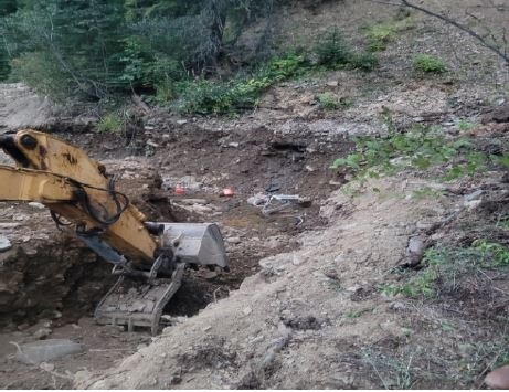 Accident scene where an individual was fatally injured when an excavated trench collapsed and engulfed him.