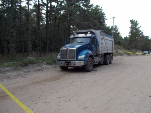 Accident scene where the truck moved forward and fatally injured the victim