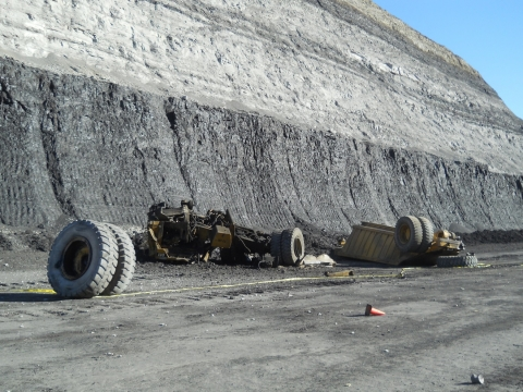 Photo of rock truck shattered on ground from where it fell, 240 feet above