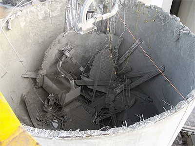 top view of a silo with its roof caved inward.