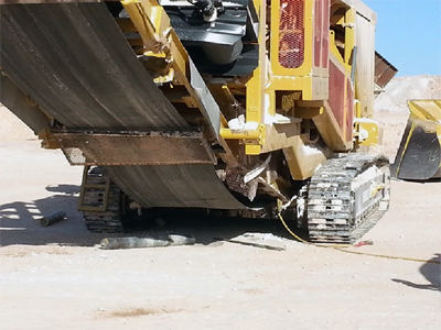 A mobile track-mounted crusher