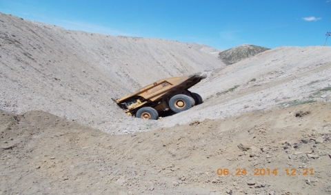 """Photo of accident scene; the haul truck is crashed into the spoil """"V"""""""