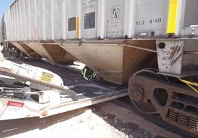 Wide angle of the rail car showing the positions the conveyor and the feed spout.