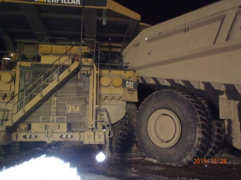 Two haul trucks after they collided.