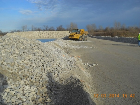 Edge of a roadway berm which was crossed by a haul truck as it ran into the water