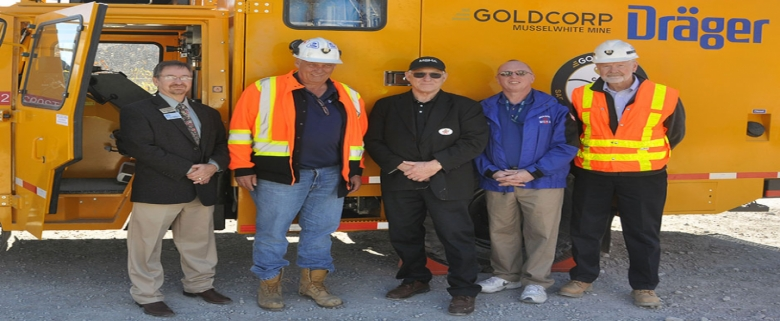 Standing in front of the Drager MRV 9000 are (from left to right) Sugar Creek Mayor Matt Mallinson, Ken xx of Drager, MSHA Assistant Secretary Joseph Main, MSHA's Chief of Mine Emergency Operations John Urosek, and MSHA's Deputy Administrator for Metal and Nonmetal Mine Safety and Health Marvin Lichtenfels