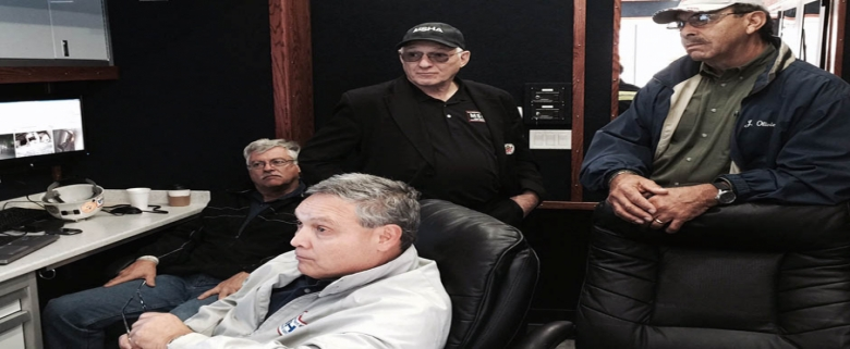 Awaiting an update in MSHA's command vehicle with MSHA Assistant Secretary Joseph Main (center) are personnel from MSHA's Metal and Nonmetal South Central District: David Weaver (front), Robert Seelke (rear left) and Joseph Olivier (right).