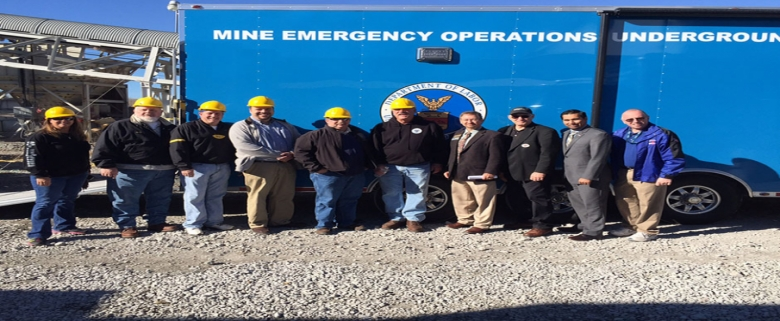 Some members of Mine Rescue Team standing in front of MSHA's Emergency Command Vehicle