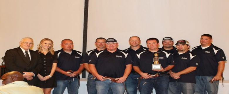 Assistant Secretary Joe Main, left, with the Vulcan Materials Blue Mine Rescue Team who placed second in the field competition.