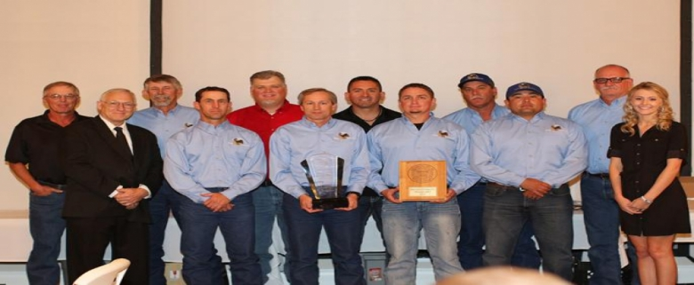 """Assistant Secretary Joe Main left, poses with the WIPP Blue Mine Rescue Team who took first place in the field competition. Team also was named """"Best Out of State""""."""