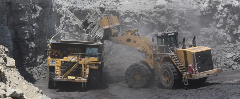 Haul trucks at surface mines