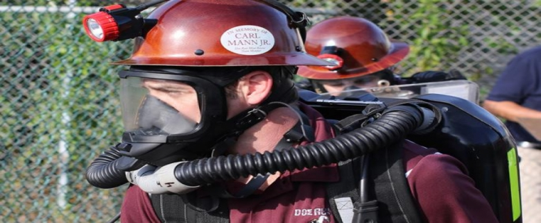 Mine rescue team members under apparatus and in competition